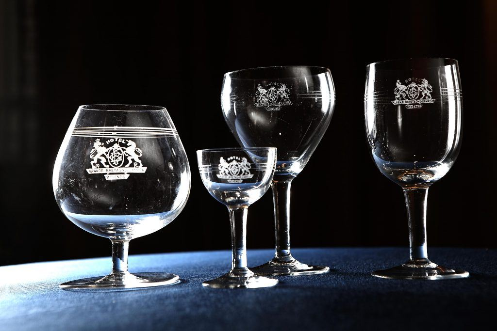 Glass collection with Hotel Grande Bretagne logo hand carved